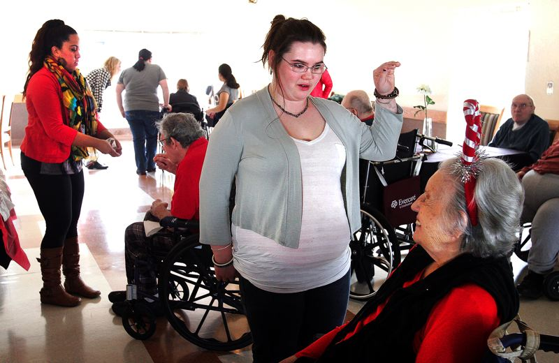 by: OUTLOOK PHOTO: JIM CLARK - Abby Smetana chats with Betty Hubert during a Valentines Day event at Marquis Retirement Facility on Thursday morning.