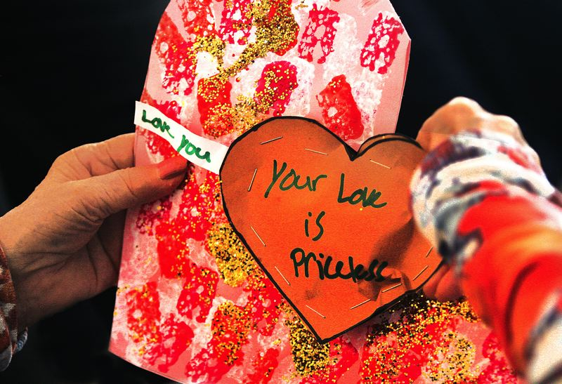 by: OUTLOOK PHOTO: JIM CLARK - Students from the Reynolds post-secondary high school program gave treats and handmade valentines to residents at Marquis Retirement Facility on Thursday morning.
