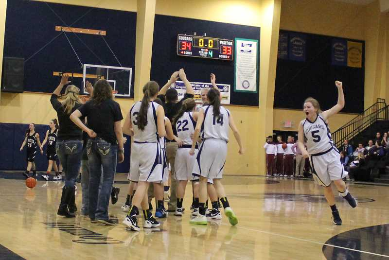 by: CORY MIMMS - The Cougars celebrate seconds after the final buzzer blew.