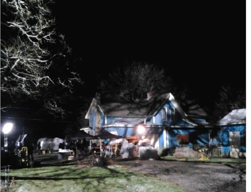 by: CAROL WESTERGREEN - Out in the Garden Nursery in Molalla lit up by banks of lights for a Grimm TV show night location shoot