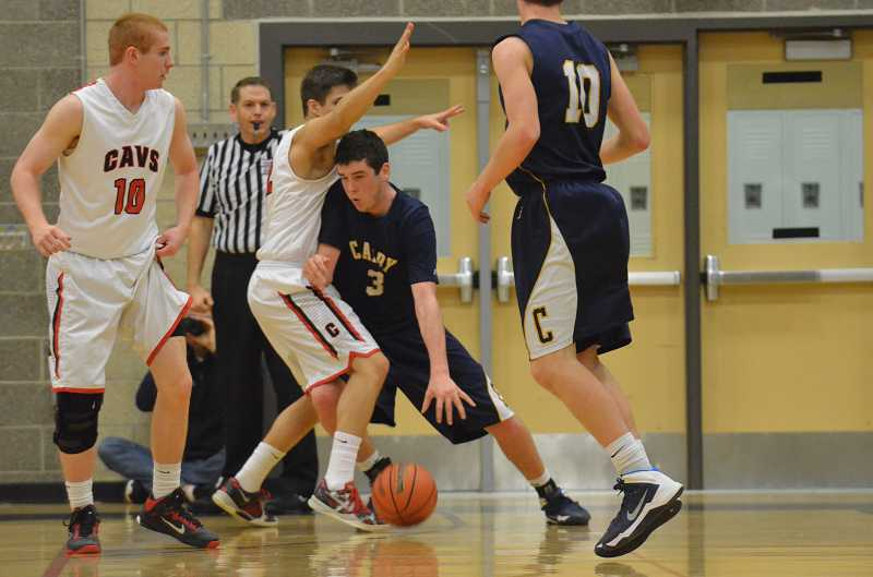 by: JEFF GOODMAN / FILE - Jordan Sanders scored 18 points to lead the Canby boys basketball team in a 56-50 overtime win over Oregon City at home Feb. 14. Above, the senior forward makes a move at Clackamas.