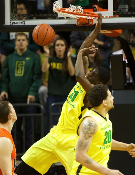 Ducks guard Damyean Dotson finishes a dunk.