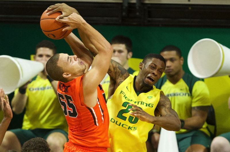 Oregon's Elgin Cook defends Oregon State guard Roberto Nelson.