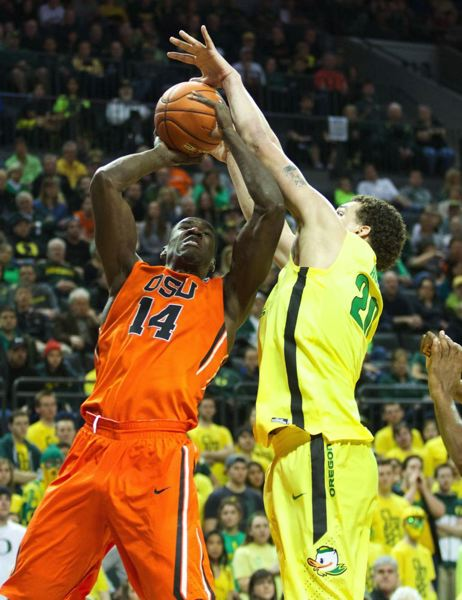 Ducks center Waverly Austin blocks a shot by Oregon State forward Daniel Gomis.