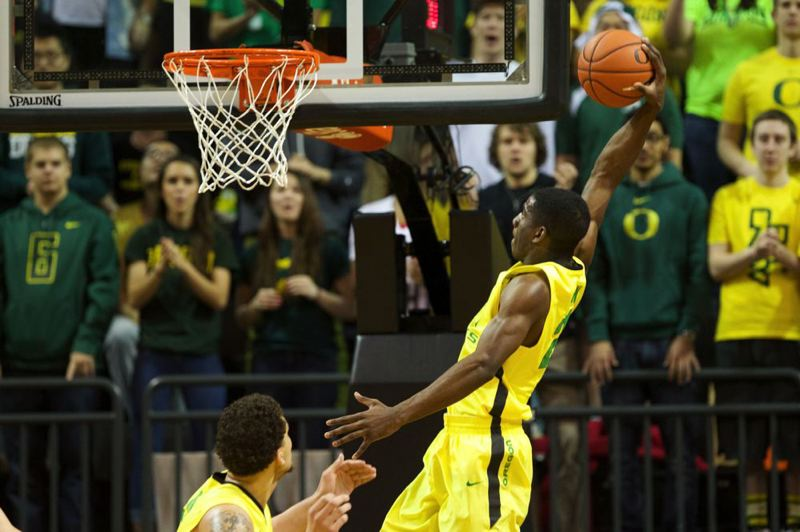 by: TRIBUNE PHOTO: JAIME VALDEZ - Oregon's Damyean Dotson goes in for a dunk during Sunday's Civil War game at Matthew Knight Arena.