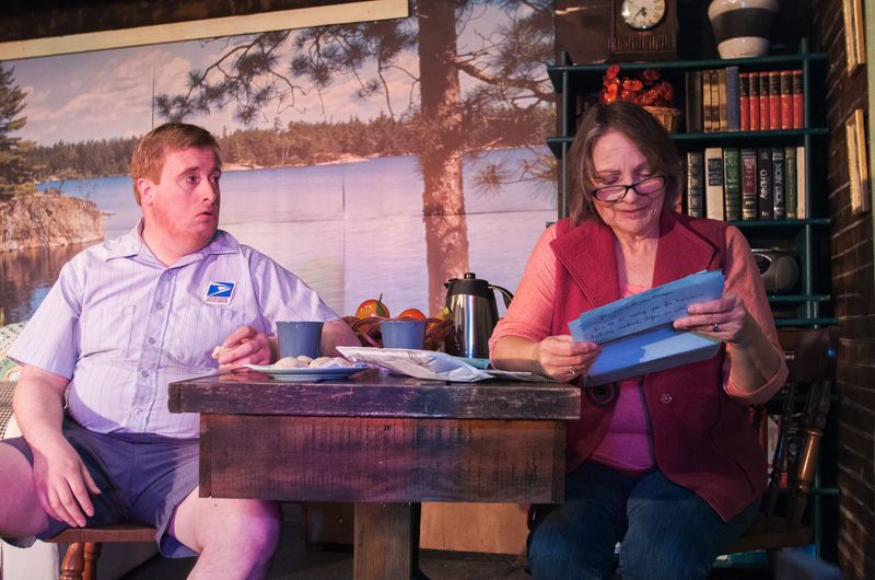 by: SPOKESMAN PHOTO: JOSH KULLA - Nathan Will (left) plays Charlie, the friendly postman who enjoys visiting with Ethel Thayer, played by Alexa MacDonald.