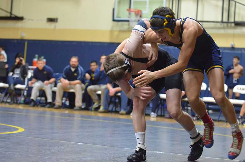 by: JEFF GOODMAN / PAMPLIN MEDIA GROUP - Nick Strnad (right) and the Canby wrestling team will compete for state bids at the regional tournament, which will be held Feb. 21-22 at Reynolds High School in Gresham.