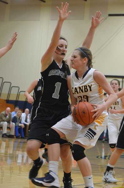by: JEFF GOODMAN / PAMPLIN MEDIA GROUP - Bailey Raines left the Canby girls basketball team's game Feb. 14 against Oregon City with a knee injury and did not return.