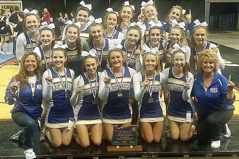by: SUBMITTED - Champs once again - The NHS cheer team poses for a photo after winning the Class 6A small division title at the championships last week in Portland.
