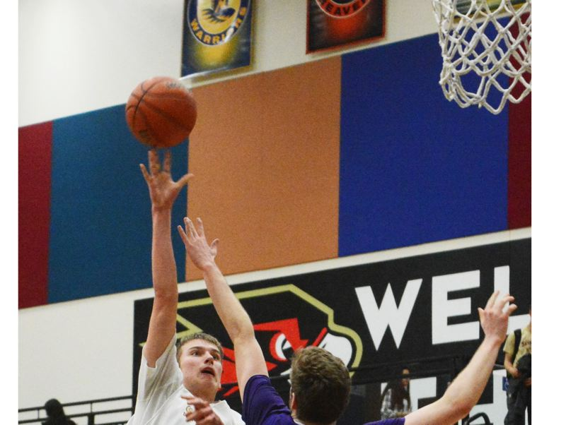 by: TIMES PHOTO: MATT SINGLEDECKER - Southridge senior post Griff Christiansen hoists a jump hook over Sunset in the fourth quarter of the Skyhawks home defeat on Thursday.