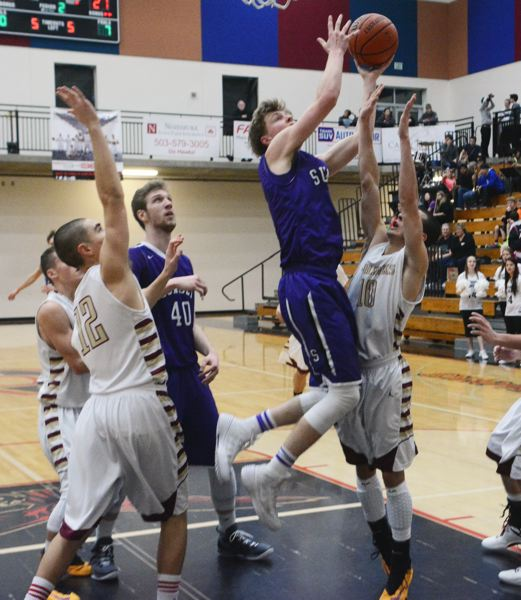 by: TIMES PHOTO: MATT SINGLEDECKER - Sunset senior wing Jeff Bieber rises high for a left-handed finish during the Apollos big win over Southridge on Thursday.