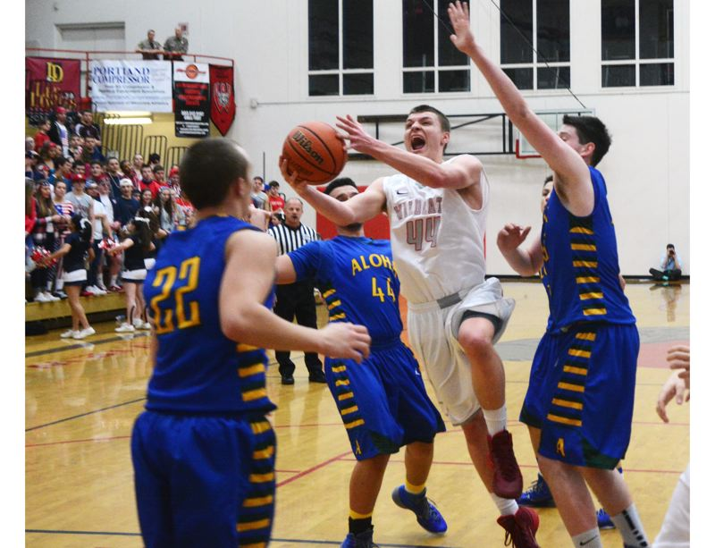 by: TIMES PHOTO: MATT SINGLEDECKER - Westview junior forward Alex Carrick's tip-in with less than 10 seconds on the clock gave the Wildcats a 49-47 win over Aloha on Tuesday.