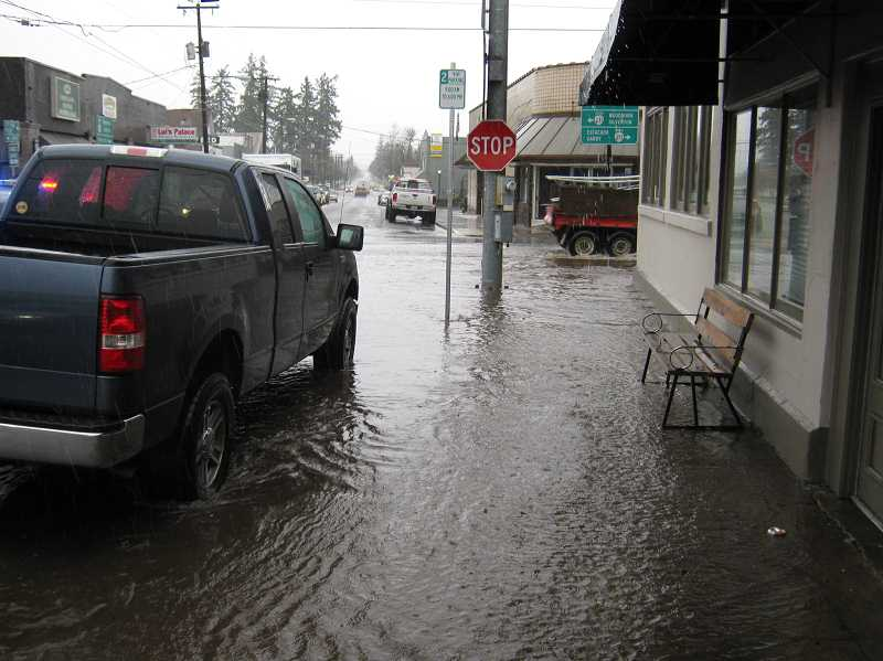 by: MPD OFFICER CURTIS THORMAN - Flooding on Molalla's Main Street in the downtown section nearly reached the front doors of local businesses.