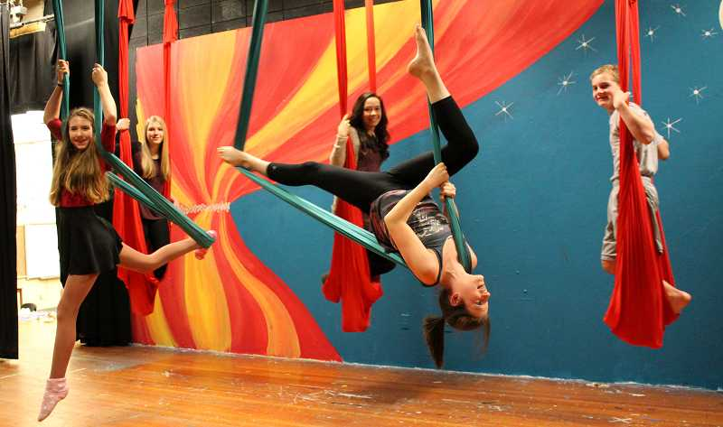 by: REVIEW PHOTO: JILLIAN DALEY - Lakeridge Junior High students rehearse scenes from Midsummer Circus: from left, back row: Jenna Wilson and Anna Garrison; and front row: Jessica McIver, Amadea Bortoli and Matty McComish.