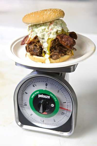 by: TIMES PHOTO: JAIME VALDEZ - The 'Totally Wrong' sandwich, consisting of smoked pulled pork, beef brisket, cheese, bacon and cole slaw, weighs more than a pound.