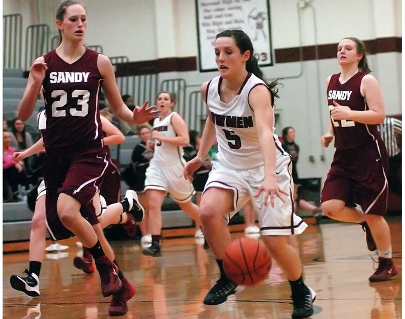 by: DAN BROOD - ON THE DRIVE -- Sherwood sophomore guard Taylor Corno (5) looks to dribble past Sandy senior Kaylee Barnett.