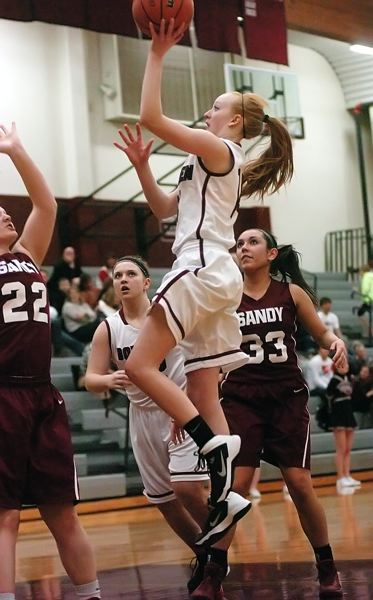 by: DAN BROOD - TO THE HOOP -- Sherwood junior guard Jennah Stobie goes up to the basket in Friday's game.