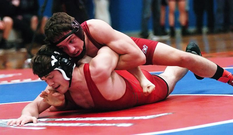 by: DAN BROOD - LOCKED UP -- Tualatin senior Blake Reser has control of  McMinnville's Bobby Crowston in the 138-pound title match Saturday at the Special District 3 regional tournament.