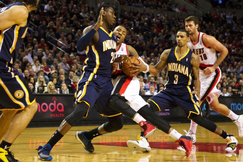 by: TRIBUNE PHOTO: JAIME VALDEZ - Can Damian Lillard and the Trail Blazers continue their drive to a high seed in the NBA Western Conference playoffs, or will the All-Star point guard and Portland run into obstacles, like Indiana Pacers center Ian Mahinmi, as they run through the rest of the regular season?