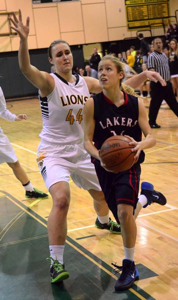 by: VERN UYETAKE - Lake Oswego freshman Cami Dozois makes a drive to the basket in Tuesday's game against West Linn. Dozois had eight points in the contest.