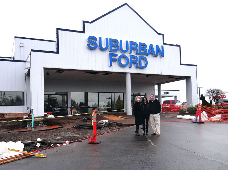 by: CONTRIBUTED PHOTO - Suburban Fords 30-year facelift will adhere to the Ford Motor Companys new design standards, but without the metal details. Suburbans owners (left to right), Nancy Jaksich, daughter Erinn Sowle and Jerry Jaksich, submitted an optional plan to Ford that would allow the exterior of the building to conform with Sandy-styles use of brick and stone.