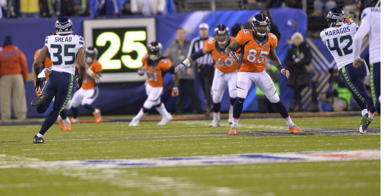 by: TRIBUNE PHOTO: MICHAEL WORKMAN - DeShawn Shead (left) covers a kickoff by the Seattle Seahawks during their Super Bowl drubbing of the Denver Broncos.