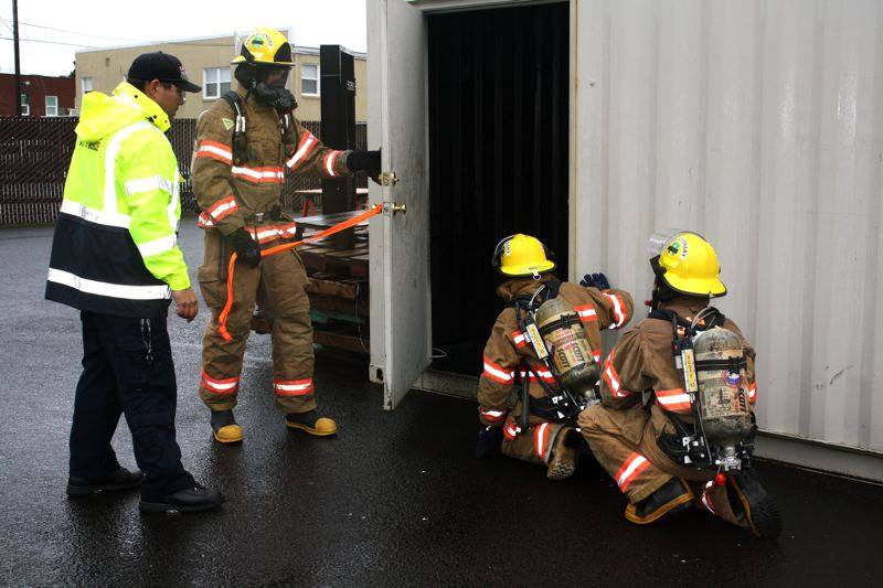 by: POST PHOTO: KYLIE WRAY - Recruits also practiced search within the maze container behind the fire house; Jeremy Parker thinks its a fun learning tool, but not everyone agrees.