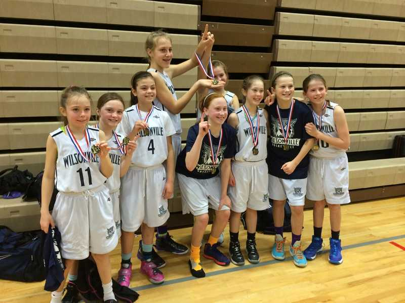 by: SUBMITTED PHOTO - The Wilsonville 5th-grade girls AAU youth basketball team defeated Albany 38-20 in the finals to win a Feb. 15-16 tournament in Tualatin. Pictured (from left): Morgan Schwenke, Sydney Travnicek, Ellie Grano, Emi Bishop, Sydney Burns, Annija Sproles, Grace Borbon, Kaitlyn Morgan and Maura Schramm. Not pictured: Sara Stewart.