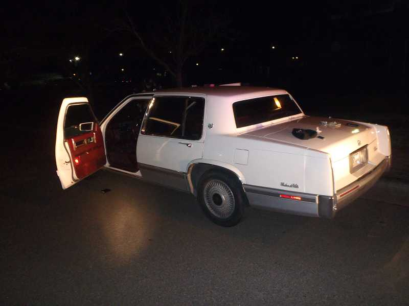by: SUBMITTED PHOTO - Sherwood Police say they pulled over this white Cadillac for a traffic infraction on Friday night. A K-9 unit found drugs and a firearm hidden inside the vehicle.