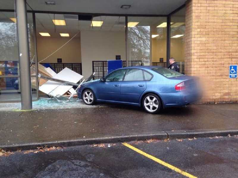 by: SUBMITTED PHOTO - Tigard Police say an elderly woman accidently drove her car through the Tigard Post Office on Monday morning.