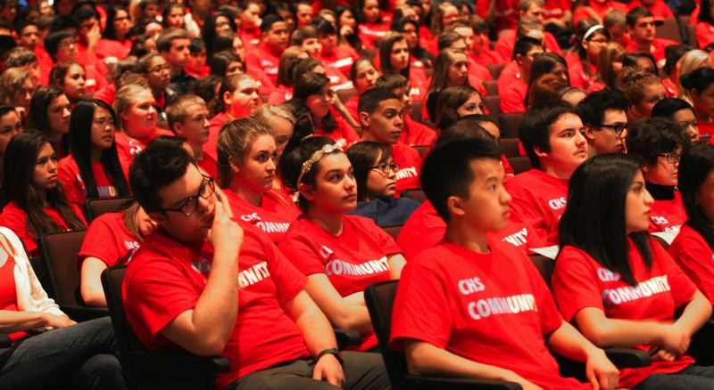 by: OUTLOOK PHOTO: JIM CLARK - Student council members James Moua and Maria Fuentes-Deonate were among members of the student body wearing bright red Centennial community T-shirts at the assembly. The shirt sales raised $1,756.60 for Classes 4 Classes.