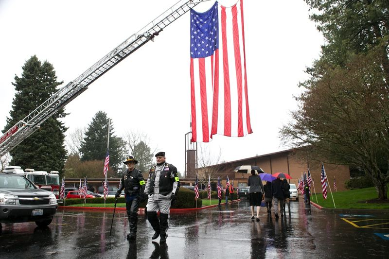 by: TIMES PHOTO: JAIME VALDEZ - Patriot Guard Riders and veterans Roy DuVal, left, and Harold 'Butch' Scott walk back to their post as guests arrive at the Church of Jesus of Christ of Latter-day Saints for the funeral of U.S. Army Spc. John Pelham, who was killed in combat in Afghanistan.