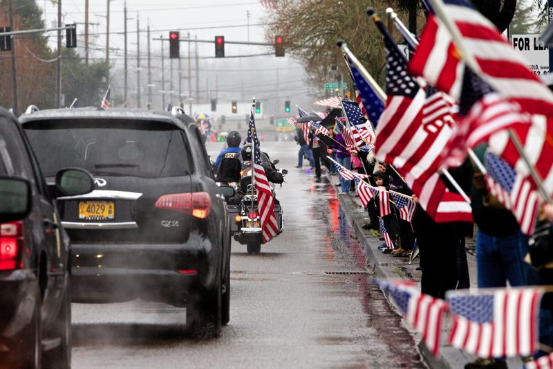 by: TIMES PHOTO: JAIME VALDEZ - Hundreds of community members lined Beaverton-Hillsdale Highway in a show of support to the family of Spc. John A. Pelham as they traveled to Willamette National Cemetery, where the Beaverton soldier was laid to rest with full military honors.