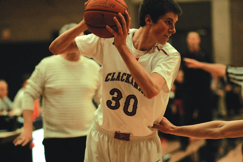 by: ESTACADA NEWS: DAVID BALL - Clackamas CC forward Grant Sitton stares down a defender. He hit the winning shot with 1.7 seconds to play last week over Mt. Hood CC.