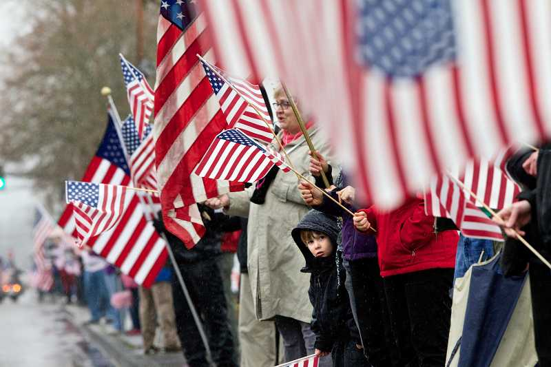 by: TIMES PHOTO: JAIME VALDEZ - An estimated 400 to 500 people of all ages took part in the patriotic tribute honoring the life and service of the 2010 Sunset High School graduate who was killed in combat in Afghanistan on Feb. 12.