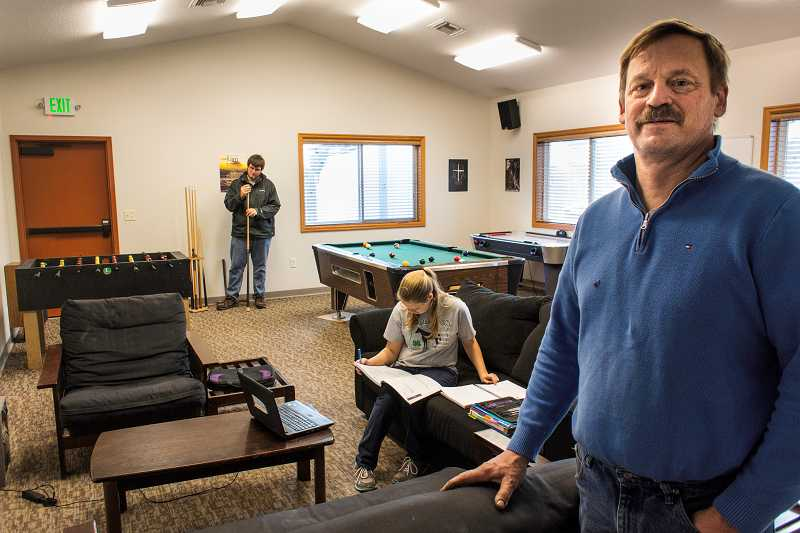 by: HUGHEY - Youth pastor Dale Hauser, right, says Canby Evangelical Church will create a safe environment at its new youth center.