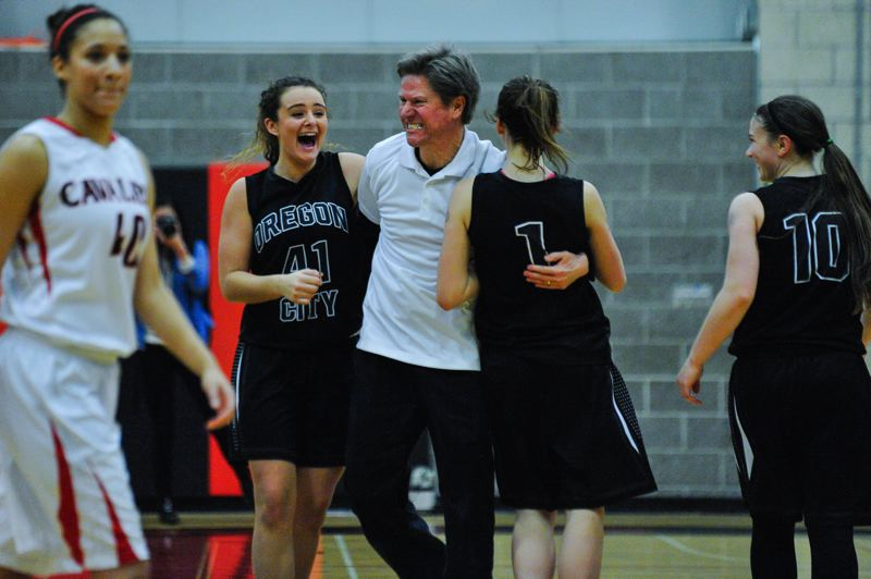 by: JOHN LARIVIERE - Oregon City coach Kurt Guelsdorf celebrates with Taylor Shaw (41) and Jessica Gertz (1) following the Pioneers 52-50 win at Clackamas. Oregon City sophomore Cierra Walker (10) also appears delighted with the outcome.