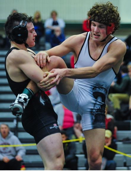by: JOHN LARIVIERE - Oregon City senior Michael Griffin (right) won a 7-6 barnburner from David Douglas Thomas Ayala-Wooden in the 182-pound championship finals of the 2014 Three Rivers League/Mt. Hood Conference Regional Championship Wrestling Tournament.