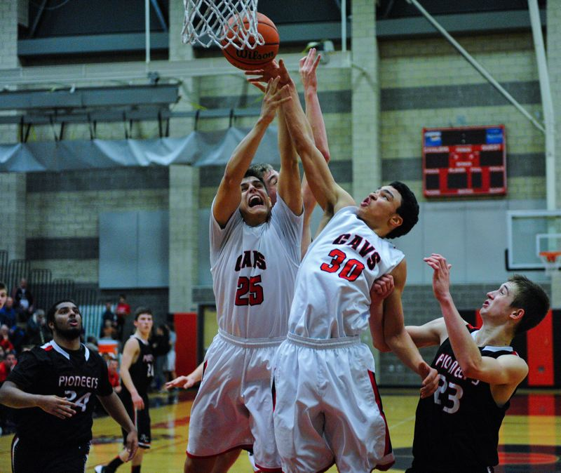 by: JOHN LARIVIERE - Clackamas seniors Andrew Gutwig (25) and Markus Golder (30) get the jump on Oregon Citys Austin DeWitz (23) for a rebound in last weeks 62-43 Cavalier rout of the Pioneers.
