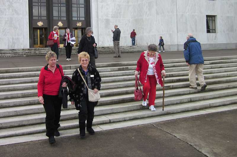 by: BARBARA SHERMAN - SO FAR SO GOOD - Members of the King City Travel Club leave the Capitol following their tour that included visiting the Rotunda, the governor's ceremonial office where he had just wrapped up a news conference, and the House and Senate, which were both in session.