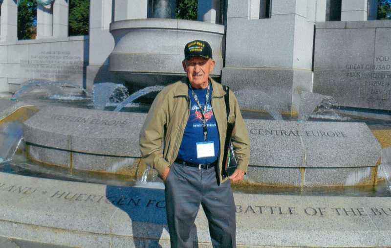 by: COURTESY OF FRANK PASSMORE - PROUD VETERAN - Frank Passmore poses at the World War II Memorial in Washington, D.C., while on an Honor Flight Network trip last September.