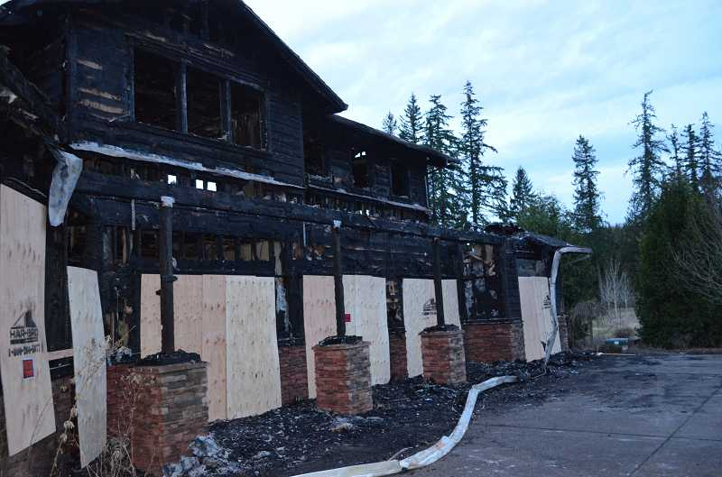 by: CLACKAMAS COUNTY SHERIFF'S OFFICE - An Estacada home was severely damaged by fire after two burglary suspects started the fire while trying to steal gasoline from a vehicle in the garage.