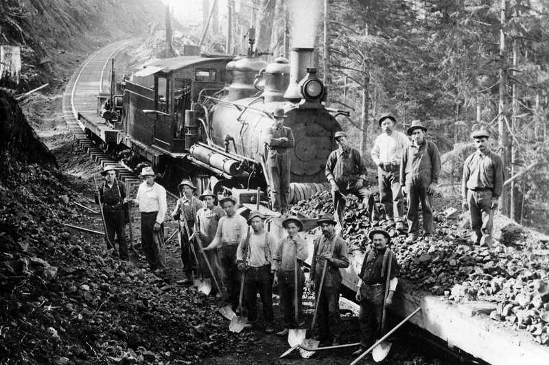 by: COURTESY PHOTO: WASHINGTON COUNTY MUSEUM - Just before the 90-mile route from Hillsboro to Tillamook opened in 1911, laborers armed with shovels arrived to clear a slide along the railroad line. The historic route may soon be turned into a trail.