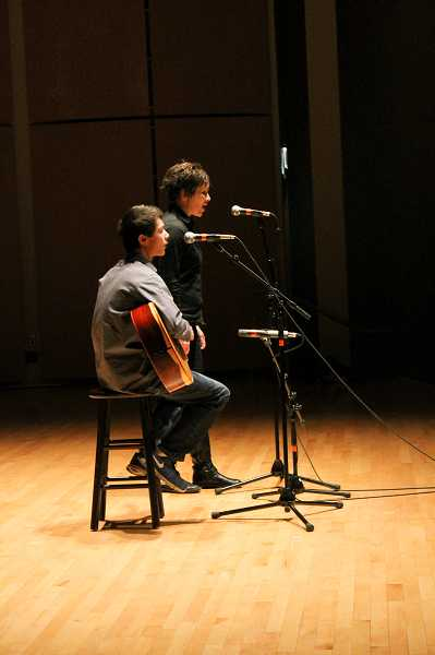 by: NEWS-TIMES PHOTO: JOHN SCHRAG - Dusti Arab and Noah Stolley (on guitar) sing 'Lack of Armor.' Taylor-Meade staff had to open a whole new row near the back of the auditorium when a large contigent of Stolley's Gaston supporters arrived at the last minute.