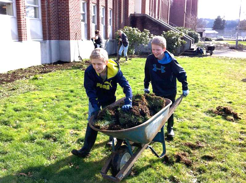 by: CONTRIBUTED - Volunteers help plot SEED's newest school garden at the Estacada Junior High School.