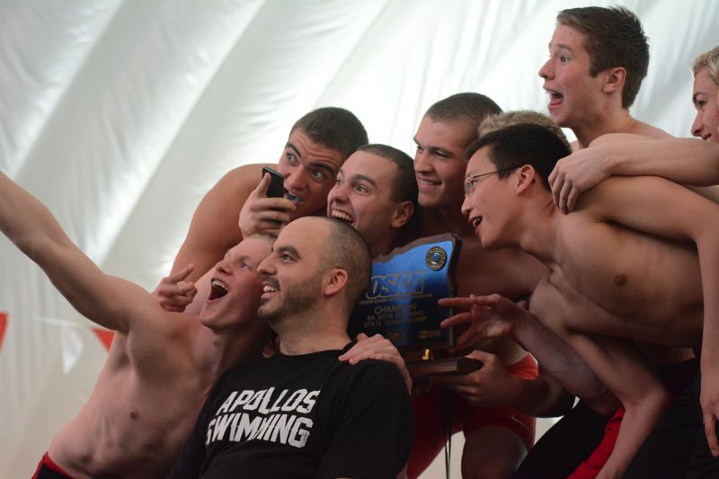 by: TIMES PHOTO: MATT SINGLEDECKER - The Sunset boys swimming team won its fourth straight state championship under the guidance of head coach Adam Farber.