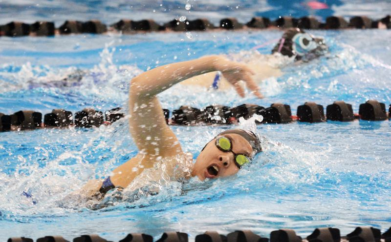 by: TIMES PHOTO: MATT SINGLEDECKER - Southridge freshman swimmer Caitlyn Wilson took second in the 500 free at the 6A state championships on Saturday. Wilson was also 5th in the 200 free.