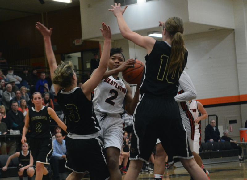 by: TIMES PHOTO: MATT SINGLEDECKER - Beaverton senior guard Danielle Hartzog celebrated senior night with 12 points and four steals during the Beavers win over Southridge.