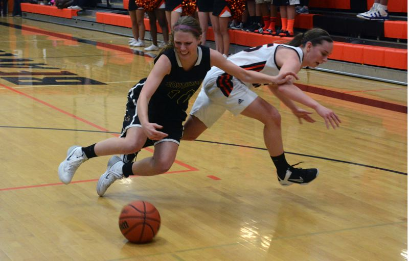 by: TIMES PHOTO: MATT SINGLEDECKER - Southridge wing Dayna Carlson and Beaverton guard Allison Mueller fight for a loose ball in the second half of the Beavers win on Tuesday.