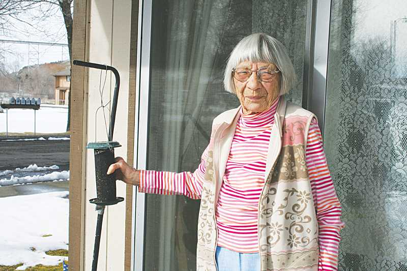 by: SUSAN MATHENY/MADRAS PIONEER - Anna Meyers, 103, keeps her birdfeeder full, so she can continue to enjoy watching birds from her apartment at Golden Age Manor.